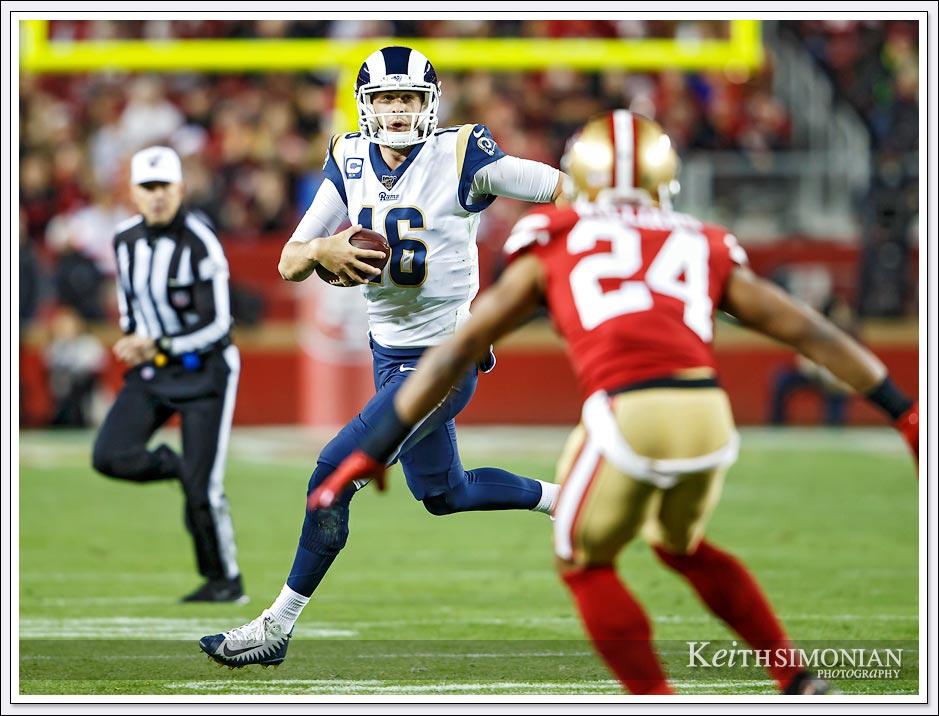 Los Angeles Rams Quarterback #16 Jared Goff eludes a San Francisco 49er defender