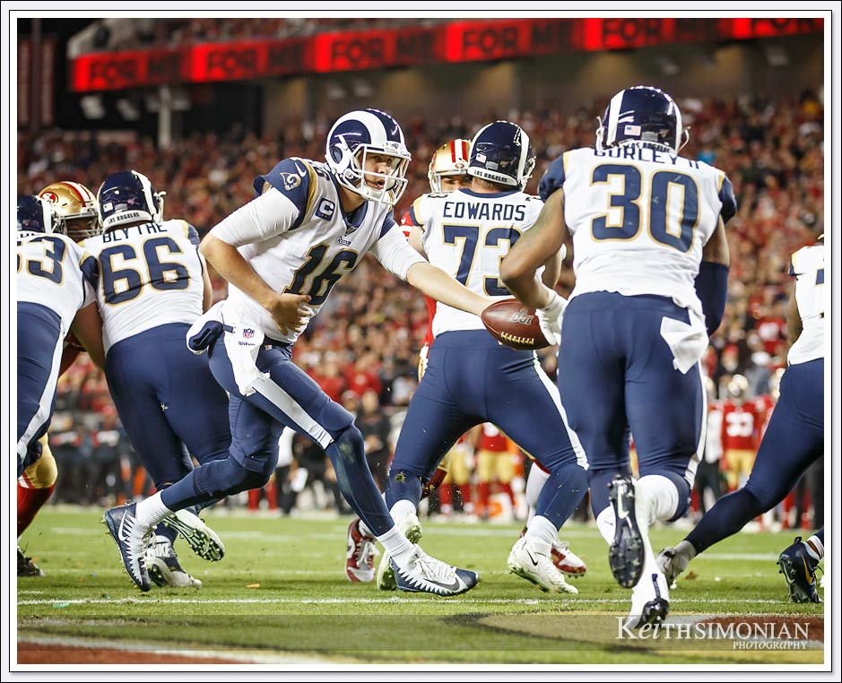 Rams quarterback #16 Jared Goff hands off to his running back at Levi's Stadium in Santa Clara.