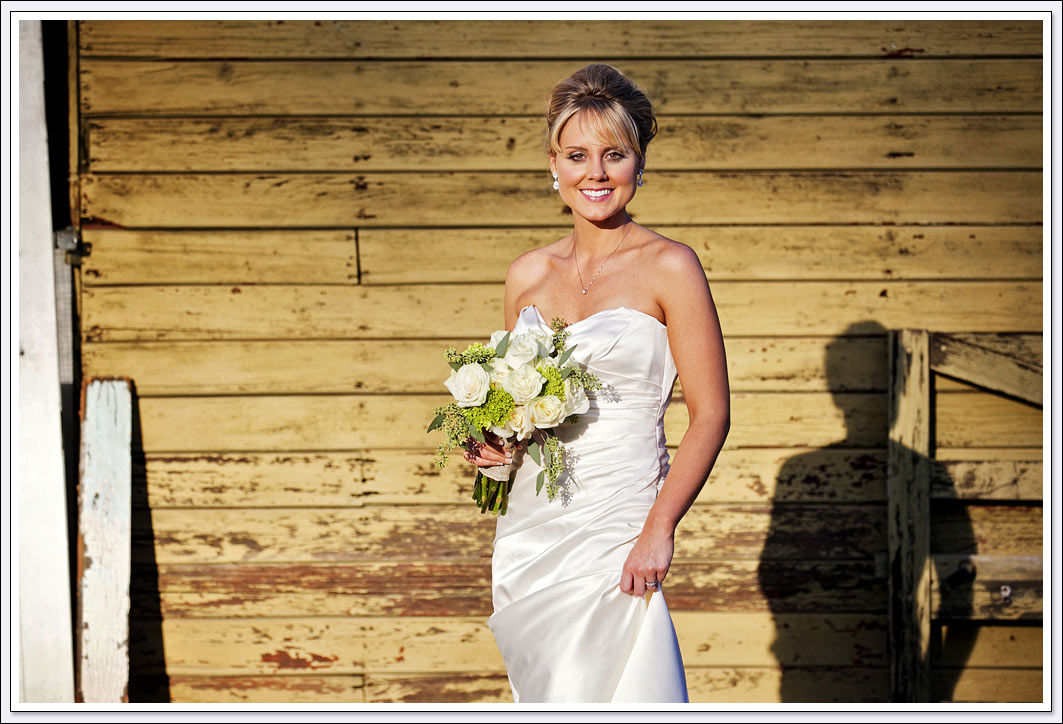 Bridal portrait in front of old building giving this photo that rustic look.