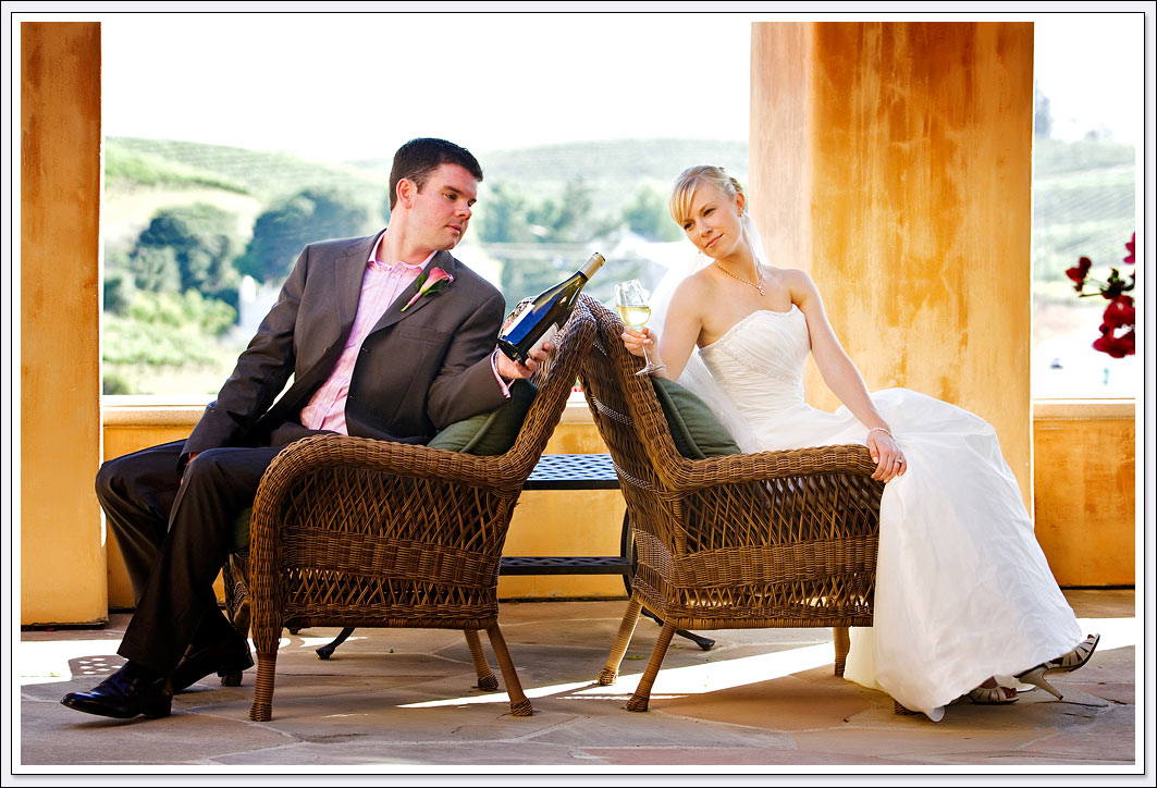 The bride and groom celebrate their wedding day with wine from the Nicholson Ranch Winery