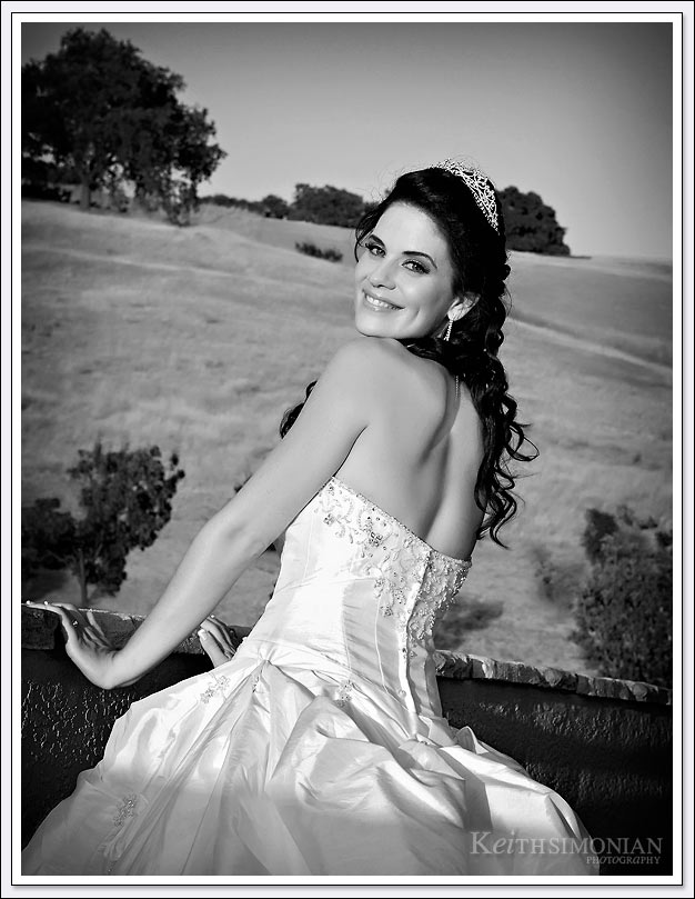 The rolling hills of the Oakhurst Country Club in Clayton, California serve as the background for this bridal portrait.