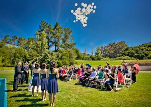 Guests watch as balloons are released during Pulgas Temple Wedding