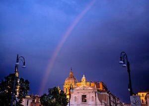 The dark sky shows this rainbow over Rome Italy