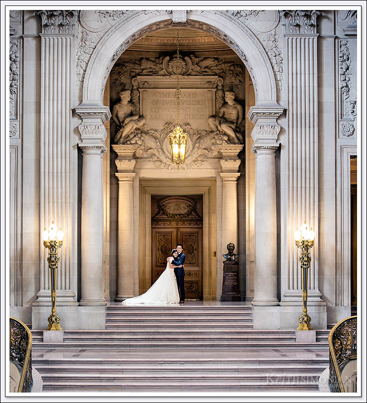 Bride and Groom pose in San Francisco City hall for wedding portraits