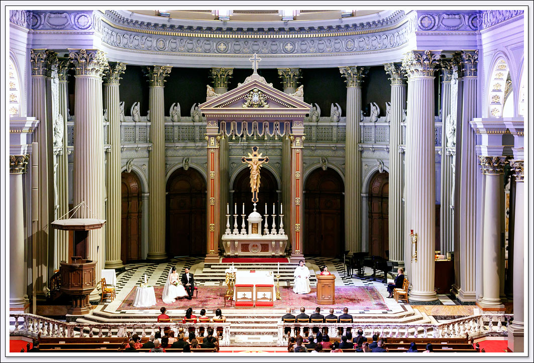 The use of a long lens from the balcony allows the wedding photographer to capture all the splendor of St. Ignatius church in San Francisco, CA.