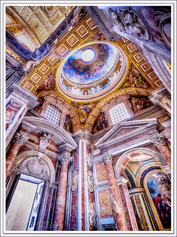 Afternoon sunlight streams through the opening in the Dome of Saint Peter's Basilica in Rome Italy - the Vatican City.