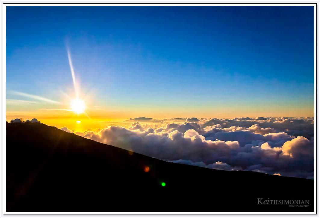 Viewing a sunset from above the clouds at the Haleakala Maui Summit.