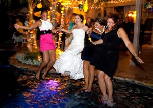 Jumping into a swimming pool to trash the dress