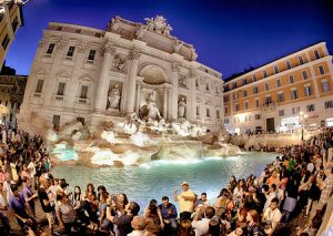 Nighttime at the Trevi Fountain in Rome Italy
