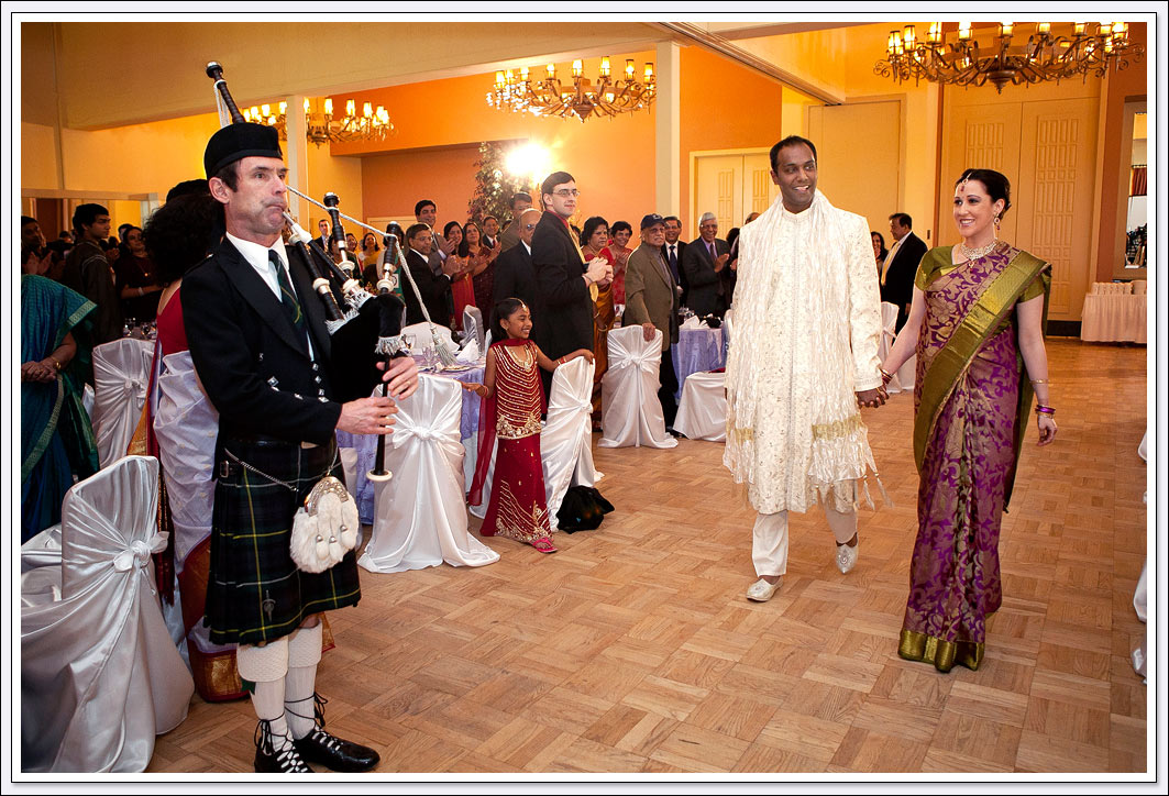 The bride and groom enter their wedding reception with bagpipes playing at Castlewood Country Club - Pleasanton, CA.