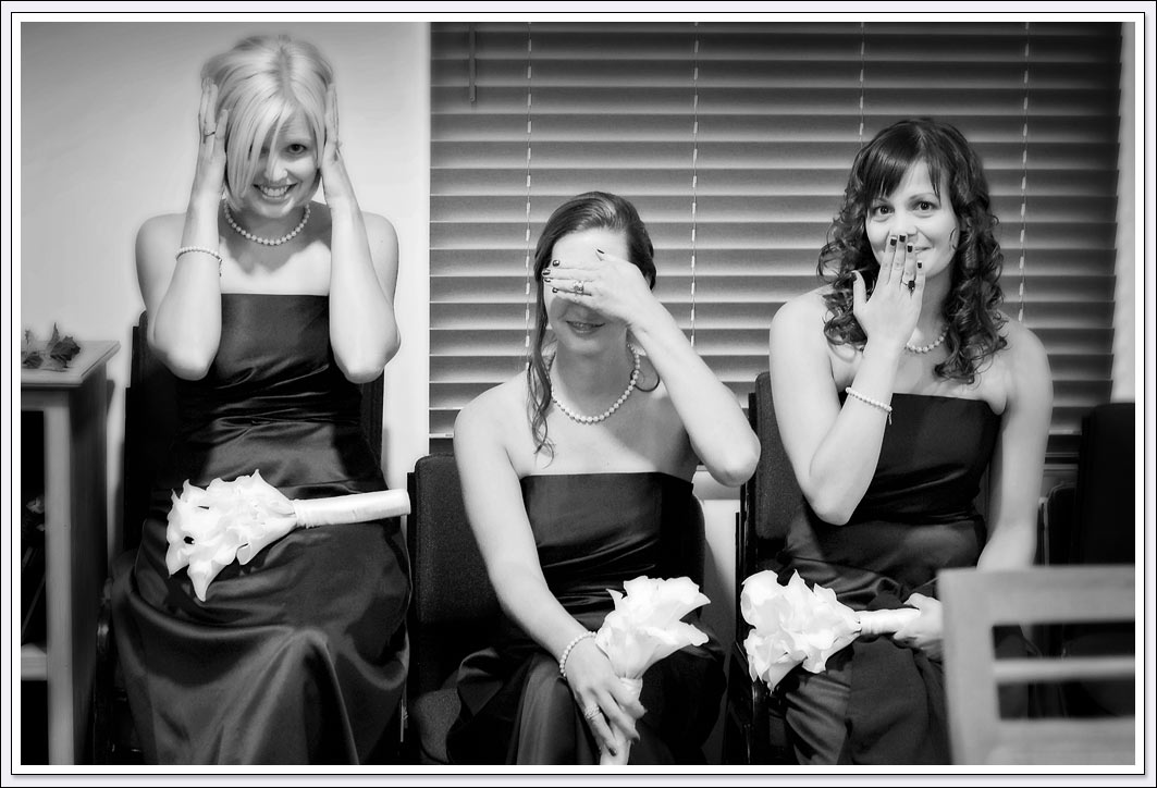 Bridesmaids pose for a goofy photo while getting ready for wedding