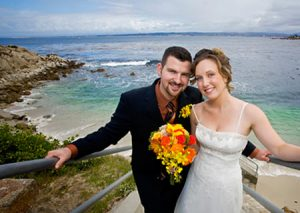 Bride and Groom pose with Pacific Ocean as backdrop - Lovers Point - Pacific Grove California