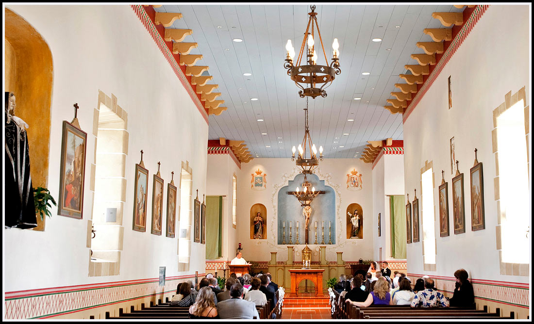 Wide angle view of guests and church during ceremony - Monterey Wedding Ceremony