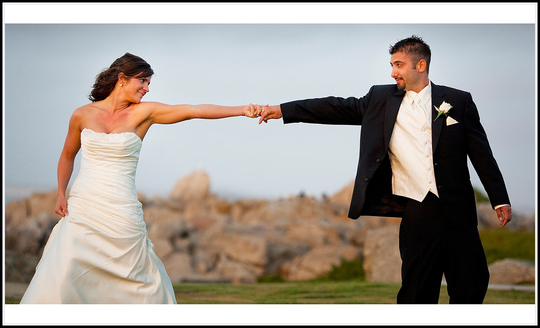 Pacific Ocean as backdrop the bride and groom hold hands - Lovers Point 630 Ocean View Blvd,  Pacific Grove, CA 93950