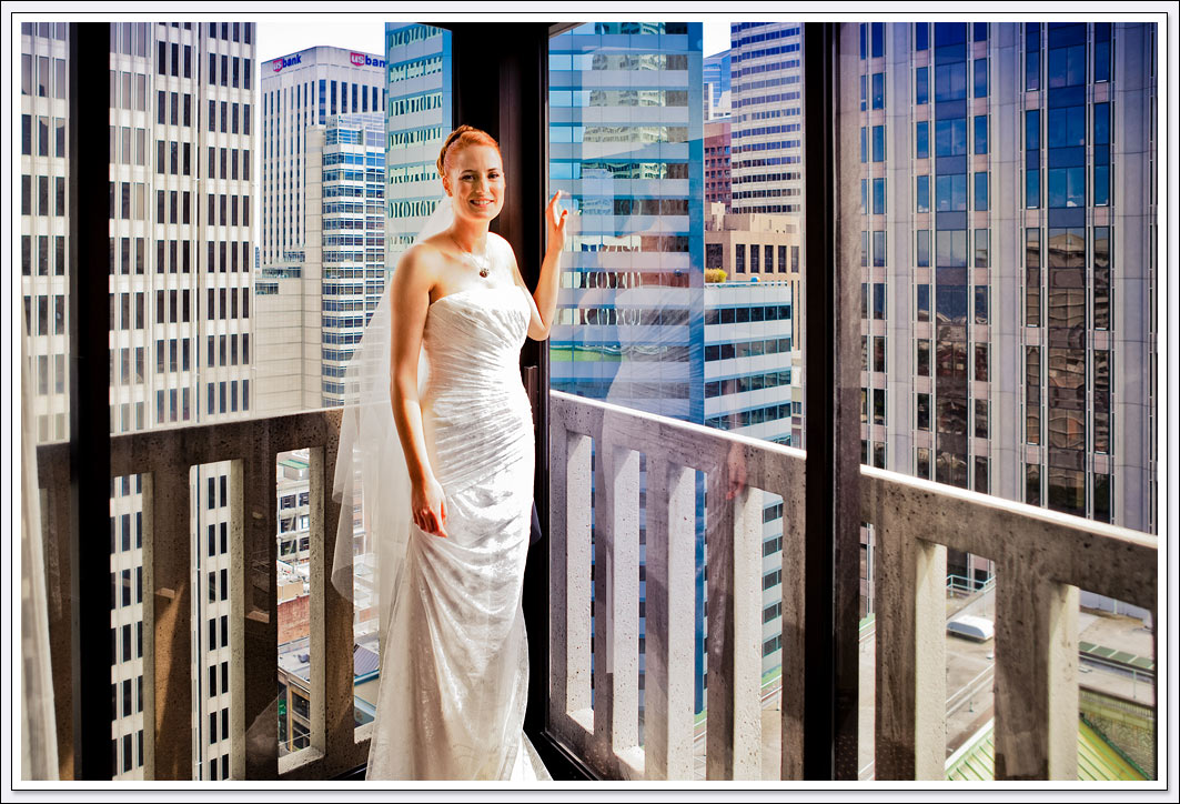 The San Francisco skyline 16 floors up serves as the backdrop for this bridal portrait.