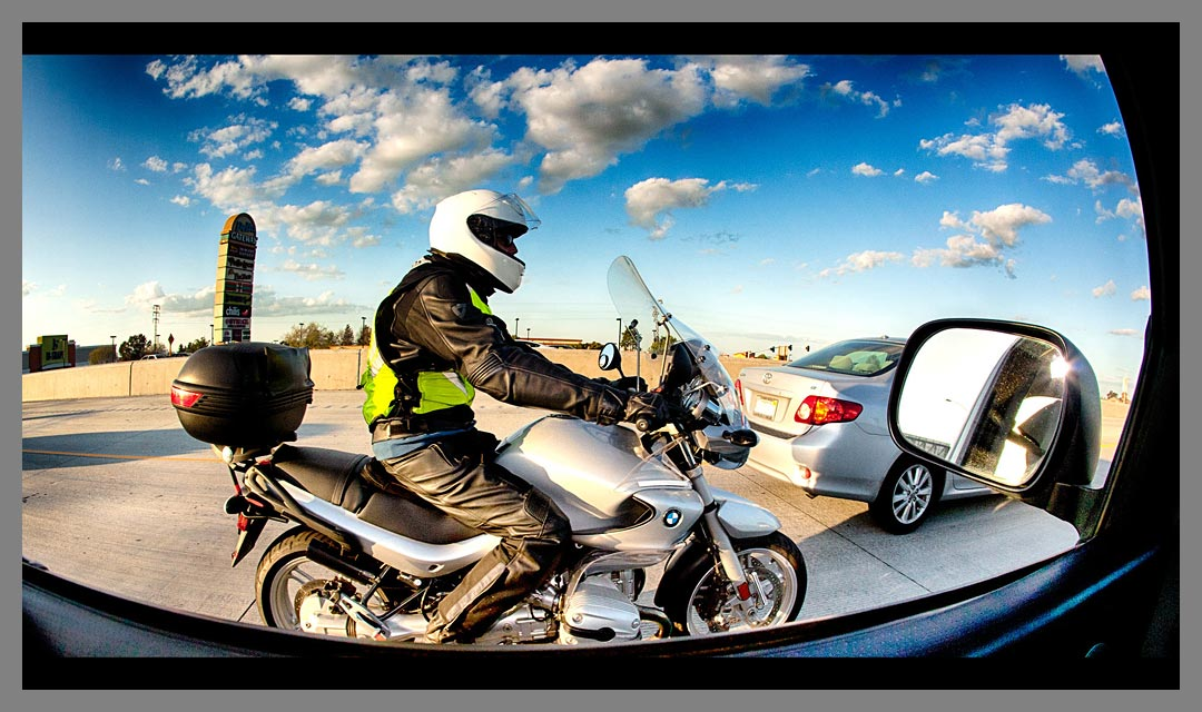 Motorcycle passing by on Highway 4 in Antioch, CA - HDR fisheye image.