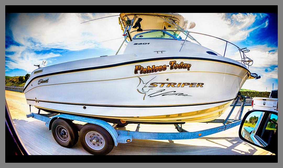 Fishing boat on trailer with the name Fishless Today Striper at 65 mph with HDR processing.