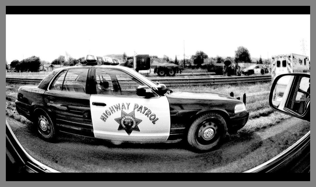 California Highway patrol car parked at accident scene - Black and White HDR conversion.
