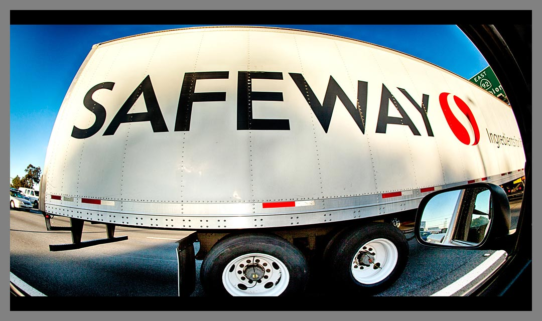 Up close and personal with a fisheye view of Safeway truck cruising down the highway.