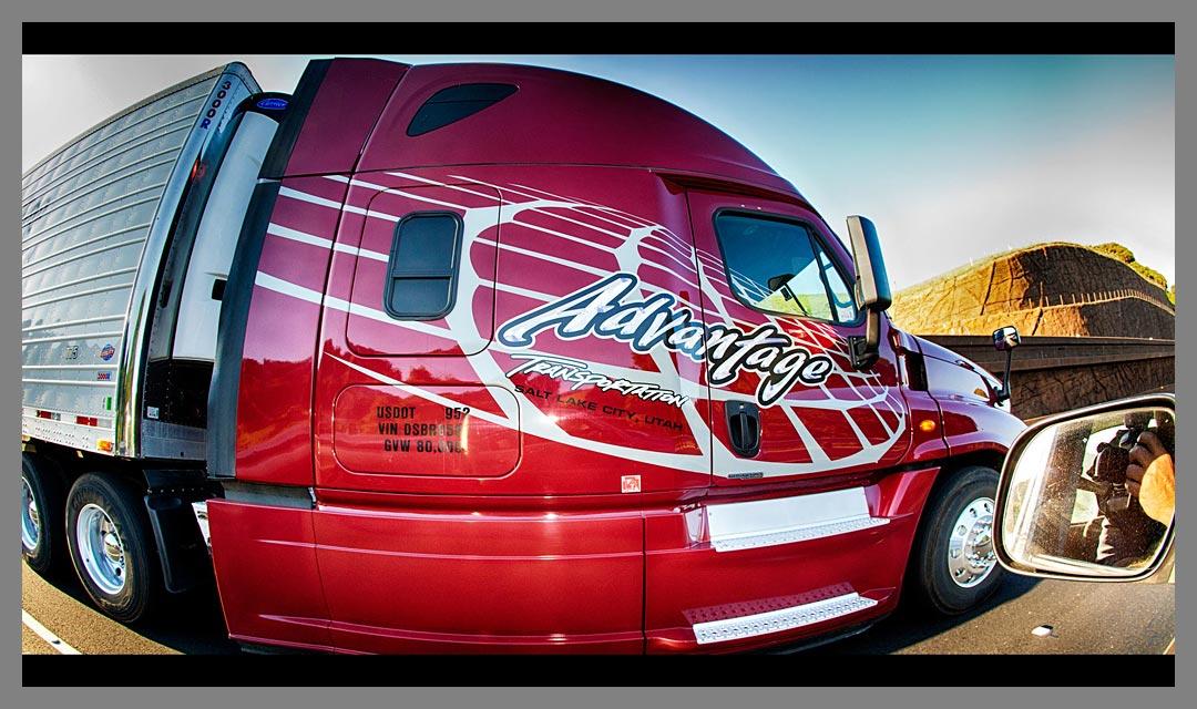 Driving alongside Red Advantage Transportation semi truck on Highway 12.