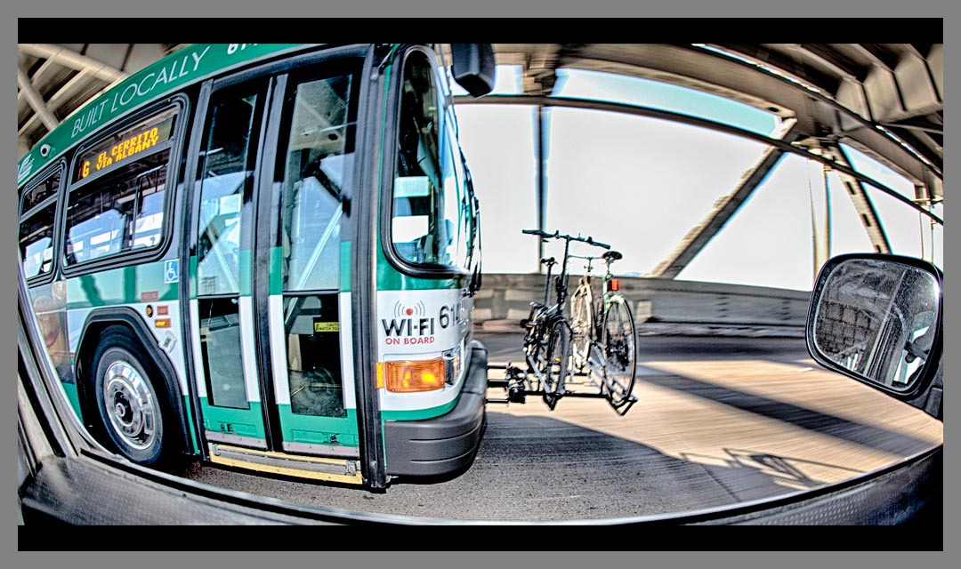 This AC Transit bus which has wifi on board is crossing the lower level of the San Francisco - Oakland Bay Bridge.