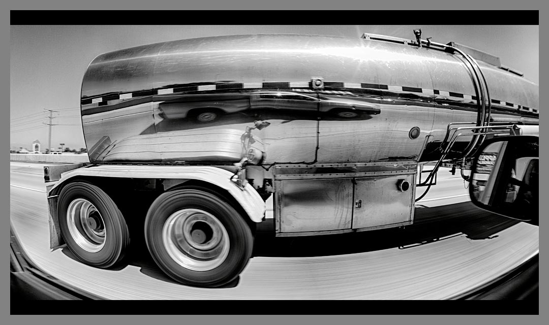 Reflection in stainless steel tanker truck on Highway 4 in Antioch, CA converted in HDR to black and white.