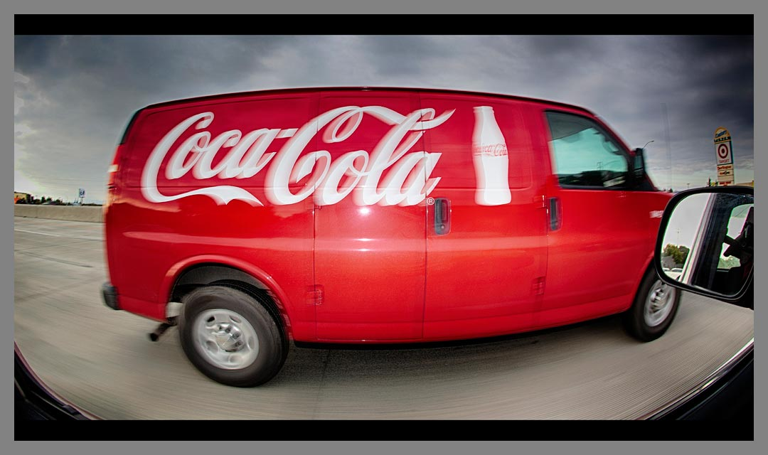 The fill flash on the Coca-Cola van makes the red color pop against the gray sky.